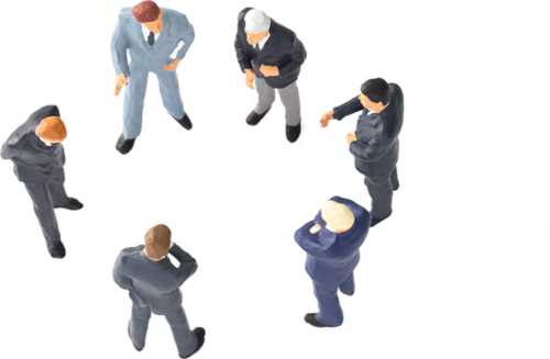 Toy business men standing in circle.